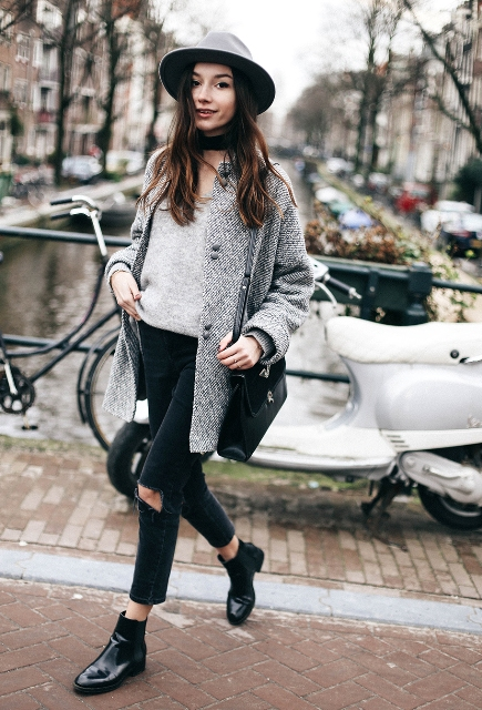 With gray shirt, tweed coat, wide brim hat, distressed pants and black bag