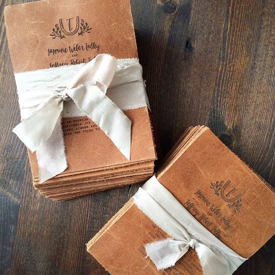 brown leather invitations with letterpressing are amazing for any wedding