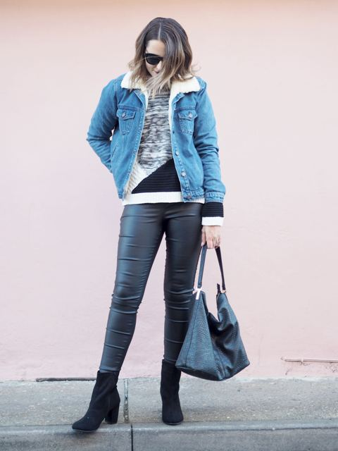 With printed sweater, leather pants, suede boots and bag