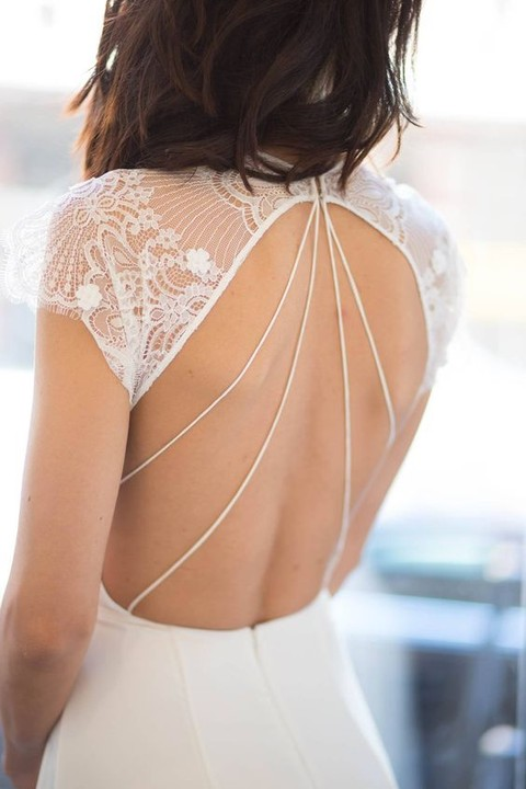 an open back with lace shoulders and a cool line detail catches an eye and looks sexy