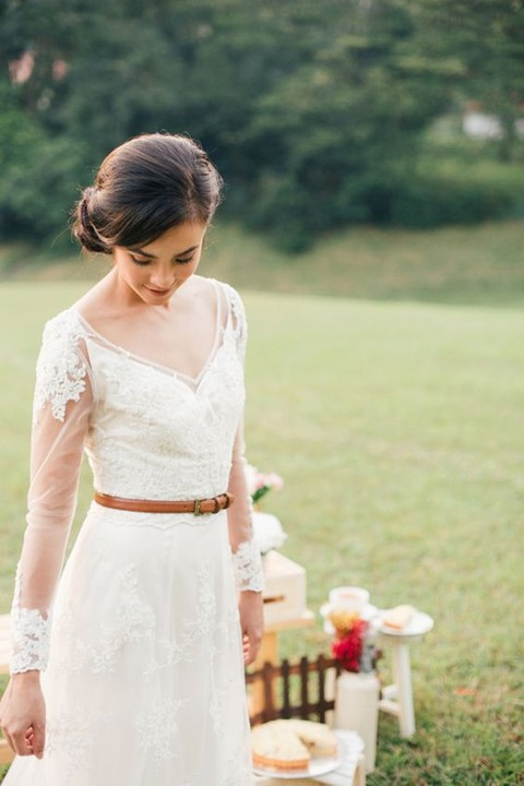 a thin brown leather belt to highlight your waist can fir a boho or rustic bridal look