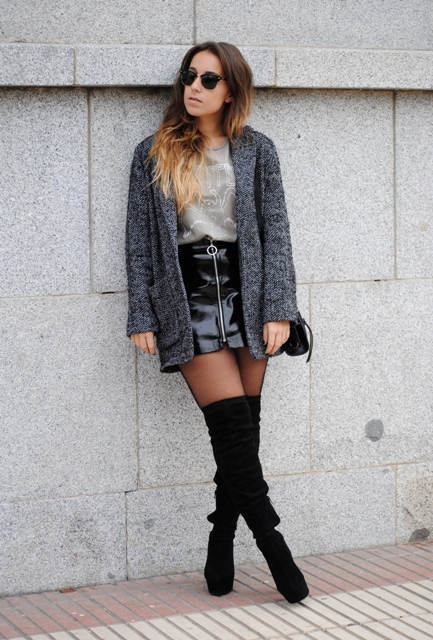With gray shirt, tweed coat and over the knee boots
