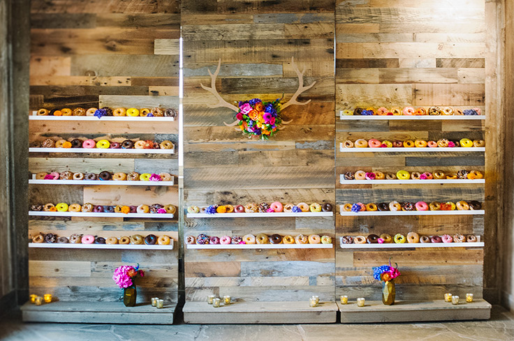 This wedding's doughnut wall is larger than life! #outdoorwedding #color #weddingdetails see more: https://ruffledblog.com/colorful-colorado-wedding-doughnut-wall