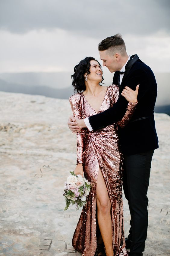 a rose sequin sheath wedding dress with long sleeves, a V-neckline and a thigh high slit for a glam bride