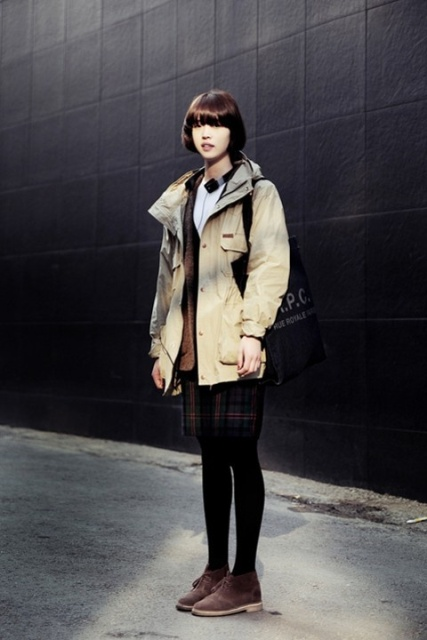 With parka coat, checked skirt, black tights and bag