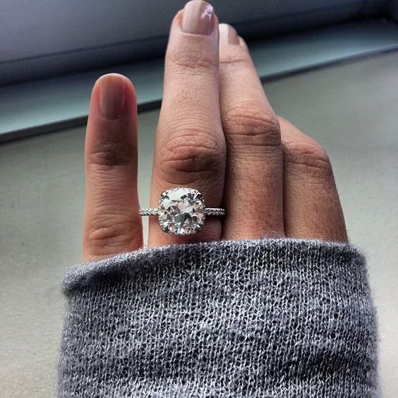 a white gold thin band engagement ring with a cushion diamond is a cute idea and will highlight your pretty fingers