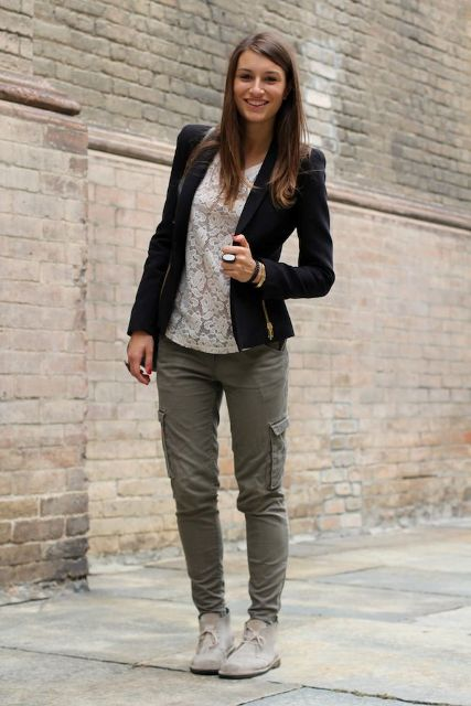With white shirt, black blazer and olive green pants