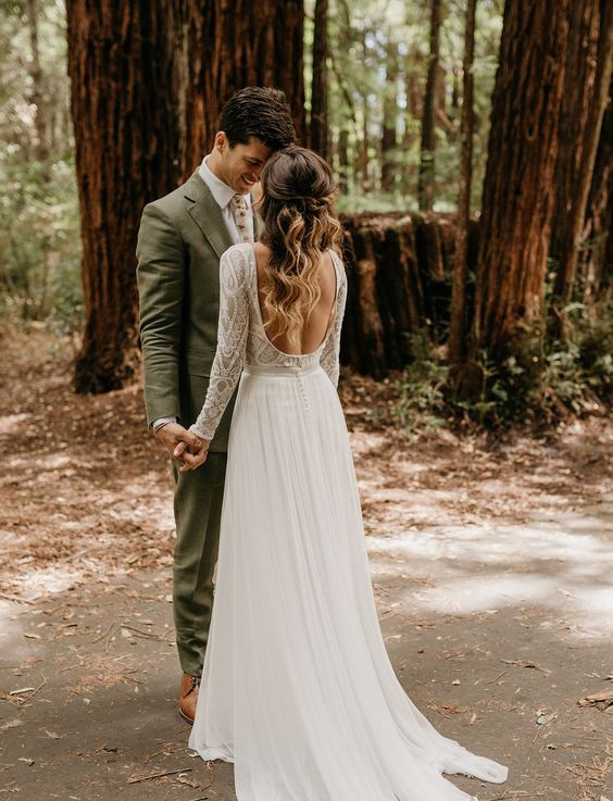 an A-line wedding gown with a boho lace bodice, long sleeves, a cutout back and a flowy light skirt
