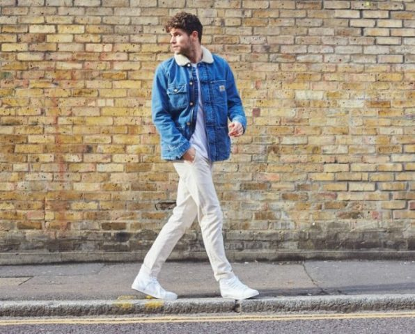 With white t-shirt, beige trousers and white sneakers