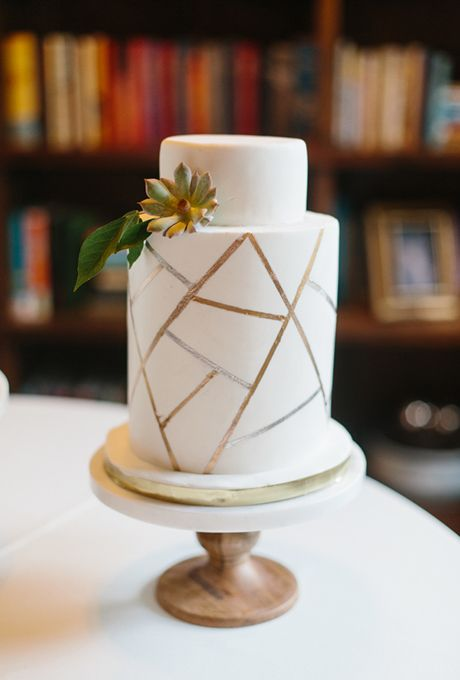 a wedding cake with copper geometric detailing is all you need for a chic look
