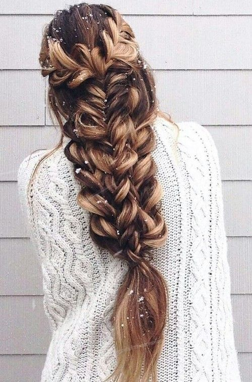 a large voluminous braid made of several braids on long hair looks just jaw-dropping