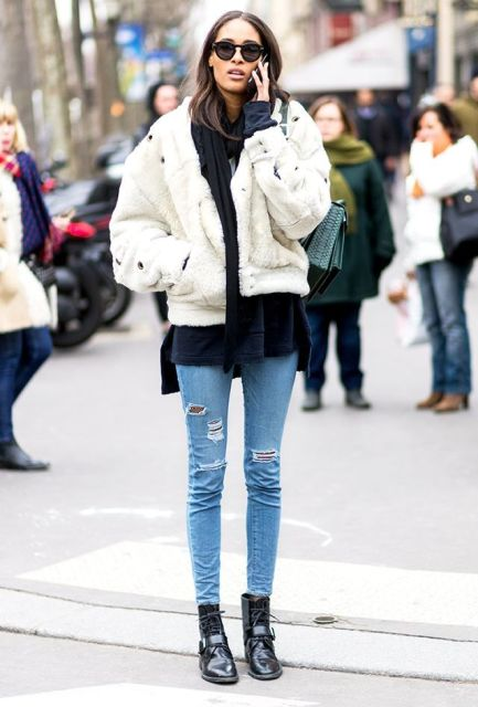 With navy blue shirt, white fur jacket and skinny jeans