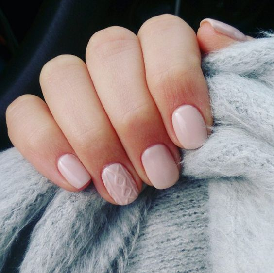 neutral nails with a cable knit accent nail is a fresh winter take on a nude manicure