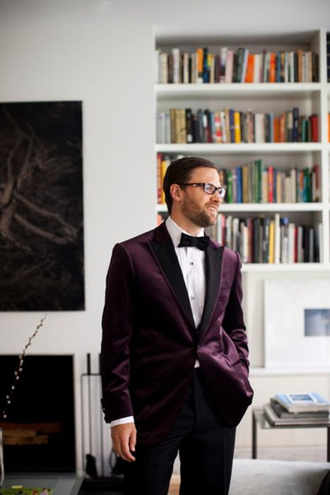 black trousers, a white shirt, a deep purple velvet jacket and a black bow tie create a very refined look