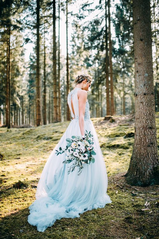 an A-line high neckline blue wedding gown with a cut back, a flowy skirt for something blue