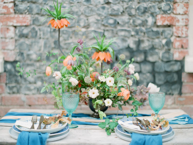 The wedding tablescape was done with a shibori table runner, blue crockery and bold statement blooms