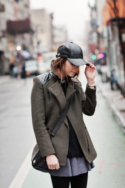 With olive green short coat, gray skirt and bag