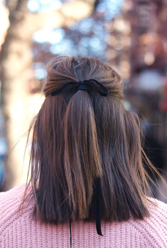 a half updo with a black velvet ribbon is a refined idea