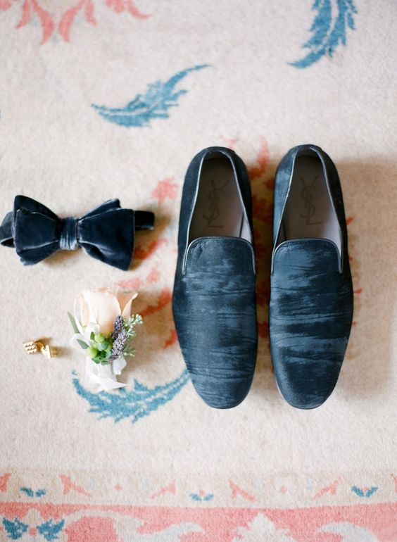 a blue grey velvet bow tie and matching loafers for a trendy groom look