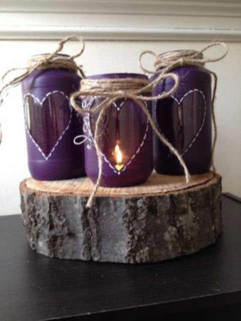 ulta violet candle lanterns with hearts, twine and on a wood slice for a rustic wedding