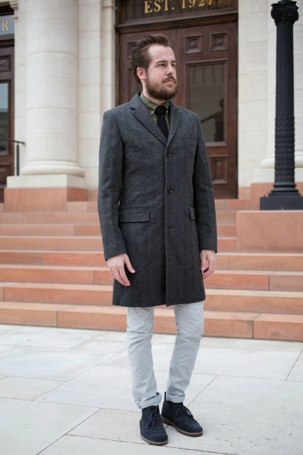 With tweed coat and light gray pants