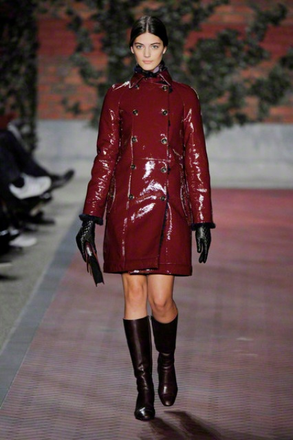 With dress, high boots and clutch