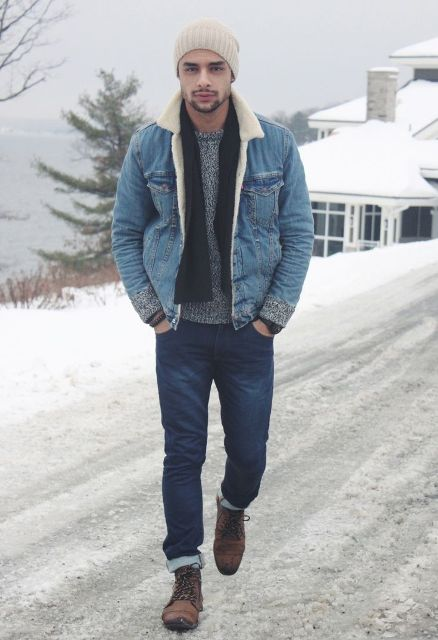 With gray sweater, black scarf, beige beanie, jeans and brown boots