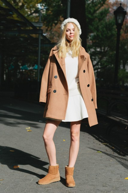 With white dress, camel coat and white beanie