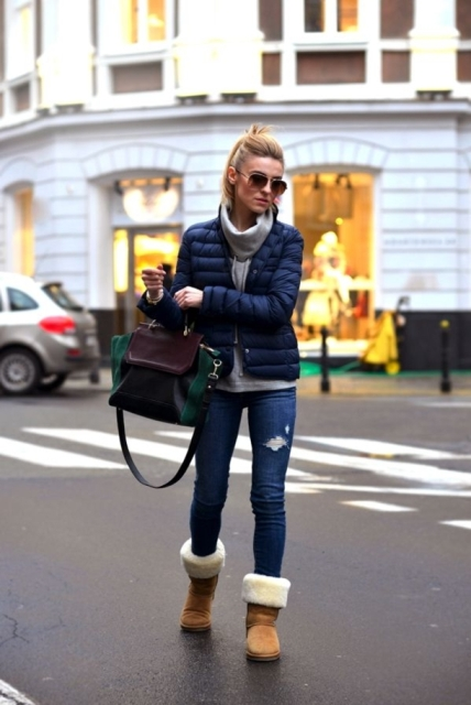 With gray hoodie, navy blue puffer jacket, jeans and green and marsala bag