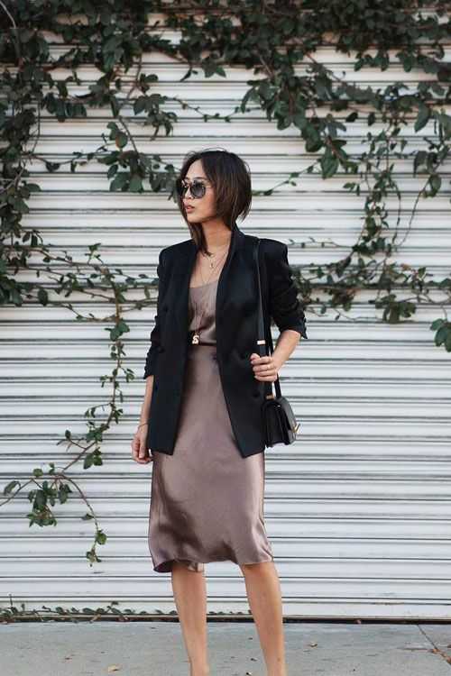 an elegant metallic knee dress, layered necklaces and a black blazer