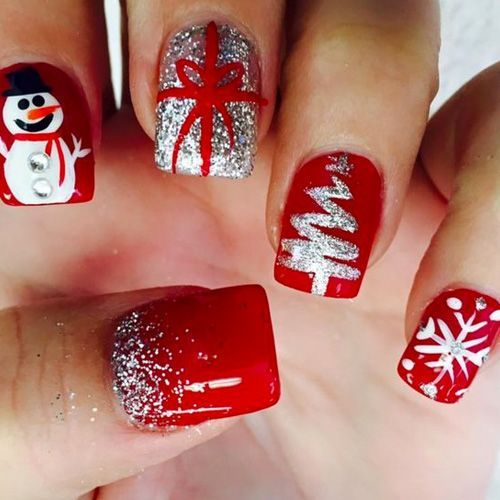 red Christmas nails with a snowman, a gift wrap, a tree, a snowflake and glitter