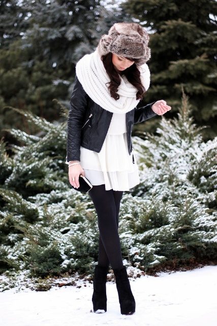 With white dress, black tights, ankle boots, leather jacket and white scarf