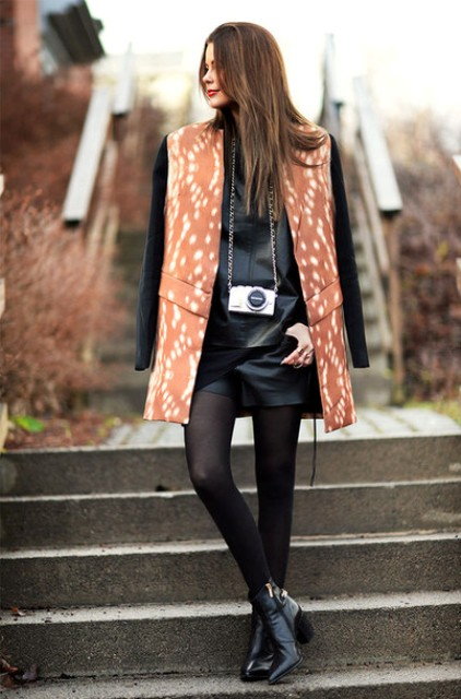 With leather shirt, ankle boots and printed coat