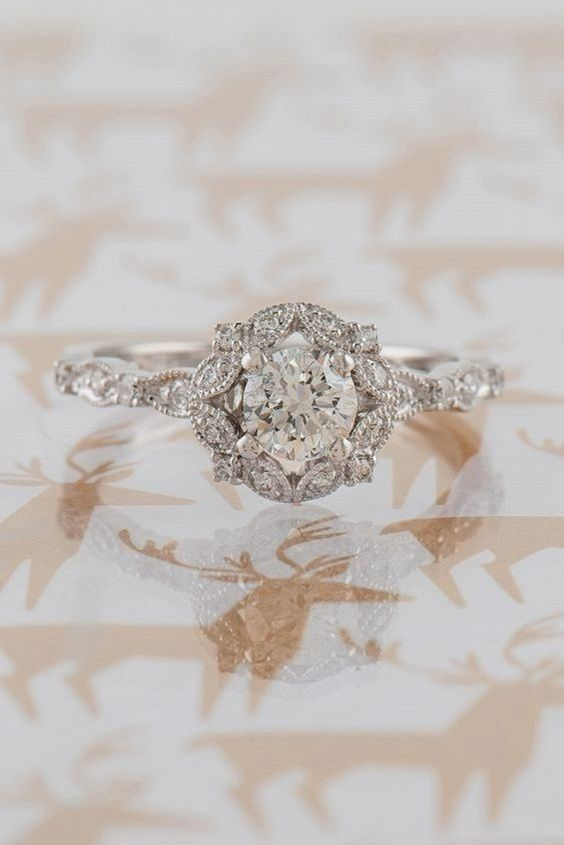 a vintage-inspired round halo vintage diamond engagement ring for a romantic girl