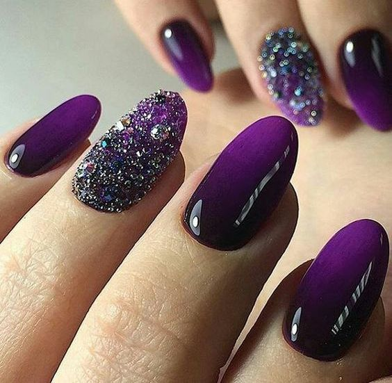 ombre deep violet nails with glitter and rhinestone accents for a party
