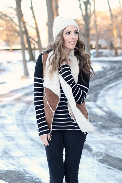 With striped shirt, white beanie and black pants