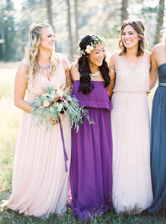 mismatching bridesmaids' dresses and a strapless boho gown for one of them is a great idea