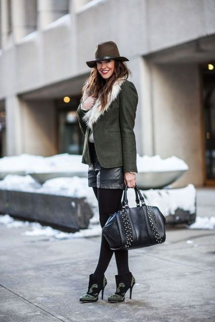 With fur collar green jacket, wide brim hat, embellished ankle boots and leather bag