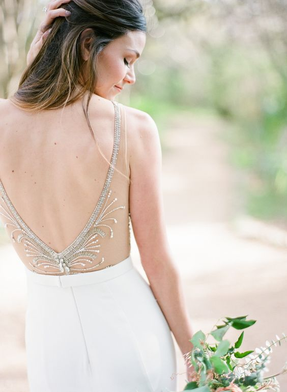 an open back with a sheer detail, embroidered and beaded to make it more exquisite