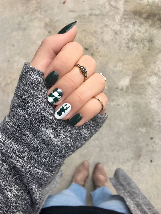 green nails with two accents - a deer head and a plaid nail
