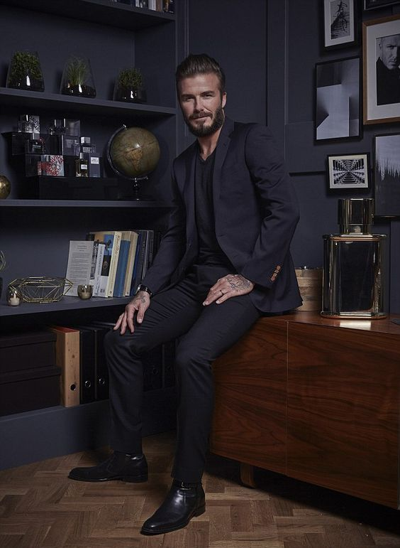 a black suit, a black tee and shoes for a chic and refined party look