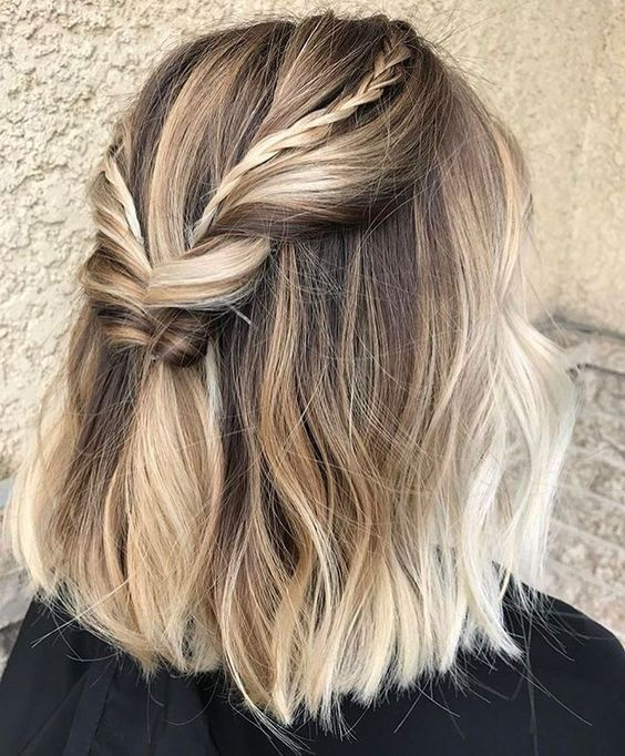 two tiny braids added to one large twisted braid to make the hairstyle cooler
