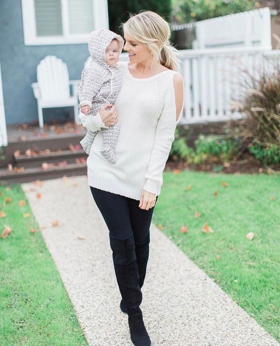 black leggings, black suede boots and a creamy cutout shoulder sweater