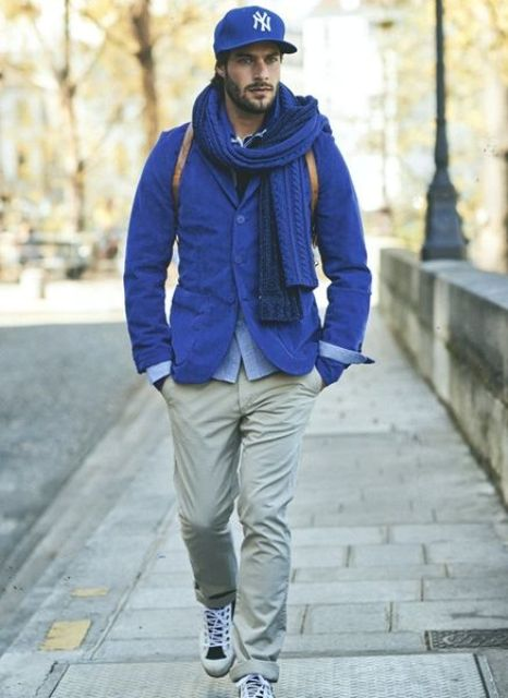 With cobalt blue jacket, scarf, beige pants and shoes