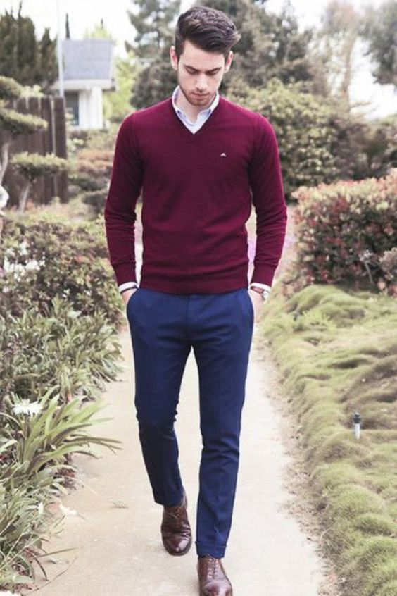 navy trousers, a burgundy sweater, a shirt and brown shoes