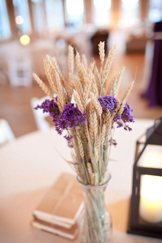 a rustic centerpiece with wheat and violet blooms is easy to make yourself