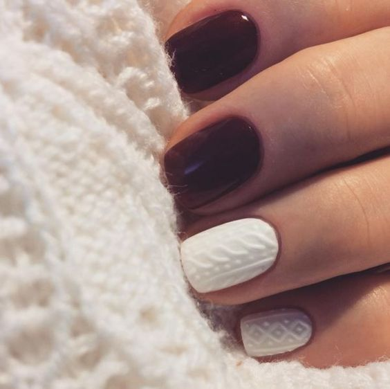 burgundy and white cable knit nails create a bold contrast and a cozy look