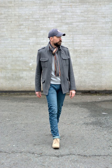 With light gray shirt, gray jacket, jeans, beige shoes and printed scarf