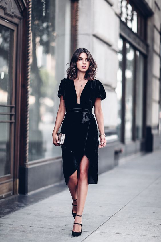a black velvet dress with a plunging neckline and a high low skirt plus black heels