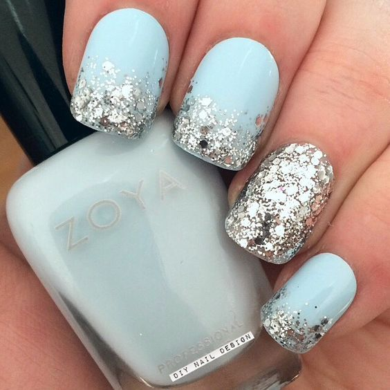 light blue nails with large scale silver glitter